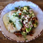 Chipotle Chilaquiles, Fried Eggs, Tomatoes, Black Beans, Red Onion, Cilantro, Queso Fresco & Avo