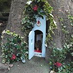 Little fairy house decorated for Christmas in a tree trunk