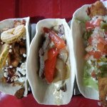 Trifecta with southern comfort, Philly cheese steak, and fried fish tacos