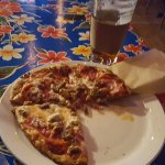 Big Meat Pizza with a glass of Hard Apple Cider