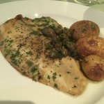 Perfectly grilled plaice with simply lemon capers and roasted new potatoes.