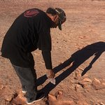 John, our Navajo guide. Highlighting the footprints with water.