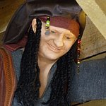 A pirate resides up in the rafters in the Nautical themed gift shop.