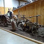 Old farm machinery with models