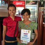 Ma Soe Soe in red and Mee Lay proudly hold their menu knowing their seafood is food 'the best'