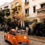The orange car parked in Montmartre.