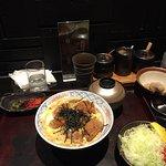 Katsu donburi. Pork cutlet with egg, onion, seasoned rice