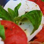 Savor the fresh buffalo mozzarella, tomatoes, & basil of Sami's Caprese Salad.