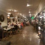 The dining area is well lit and inviting with tempting bakery items, coffees and wine.