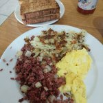 Corn Beef Hash with Scrambled eggs and Hash Browns. Multigrain toast