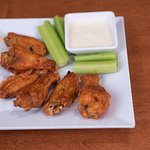 Try our buffalo wings at the Over/Under Bar and Eatery