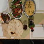 Best fresh lamb seekh kabab,naan and red wine.