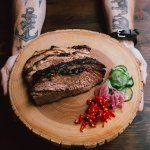 Brisket smoked for up to 20 hours served with our house made pickled chiles, cucs and onions.