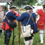 "Re-enactors preparing for a ""battle"" at Fort Massac"