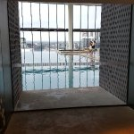 27th floor views from lift doors into pool .