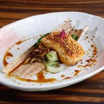 Paiche seared w/ garlic panko breadcrumbs. Served with bok choi, oyster mushrooms & sweet soy sa