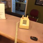 With nobody at the front desk, a sign says to call staff on this phone.  Still nobody.