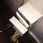 This was the only electrical outlet near the bed, behind the nightstand, that you could plug int