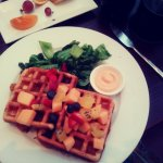 Waffles with fresh fruit and tender greens