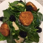 Fried Goat Cheese Medallions over a bed of Baby Spinach