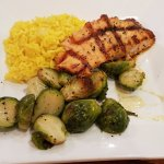 Grilled salmon with brussel sprouts and box saffron rice
