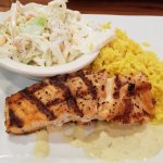 Grilled salmon and cole slaw and boxed saffron rice