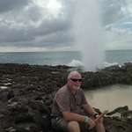 Discovering a blow hole in the vulcanic rock on Cozumel Beacho