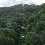 Cable lift to the top of the mountain, view along the way and a glimpse on the bobsled track.