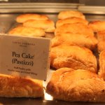 A Maltese Fave: Pastizzi (Pea Cake). Proudly displayed in the front counter heaters as you walk