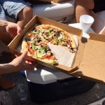 We ordered pizza while traveling on our boatand took it to go!