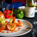 A yummy Fresh River Lobster with layer of roasted bell pepper salad