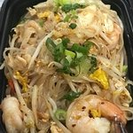 Pad Thai plus more spicy: a famous rice noodle dish with chicken , shrimp, egg, bean sprout, pea