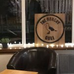 The hungry gull logo inside the restaurant