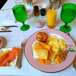 A breakfast plate - blintzes, scrambled eggs with smoked salmon