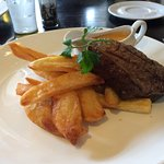 Rump steak (medium rare) with chips and a delicious pepper sauce