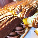 Eclairs filled with vanilla and chocolate pastry cream.