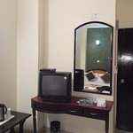 A basic mirror in room with tv