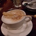 after-dinner cappuccino with rock candy swizzle stick