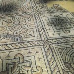 The intricate patterns of the mosaic floors