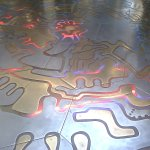 Artwork on the reception floor. The lights below are triggered by the impact of cosmic rays.