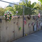 Orginal Memento wall (fence). Some items have been here for 20+ years.