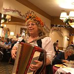 Accordion Player going to tables, singing and playing songs