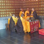Monks performing a ceremony or a special prayer .
