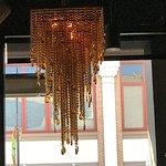 Gold chandelier Cactus Club Cafe 1125 Douglas St, Victoria, British Columbia