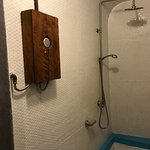 cute home-made box around the shower unit and cute home-made wooden tap for shower