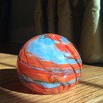 This paperweight reminds us of the wonderful red hill and beautiful blue skies of New Mexico.