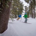 A couple enjoying King Pine Ski Area that is part of Purity Spring Resort