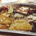 Fritanga ( platter of carna asada, chancho frito, tajadas frtas, platano frito, yacca, chicharro