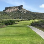 Hole 9 par 4 with a tough green and great mountain view