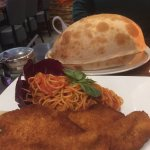 The Calzone before it was breached, together with the Milanese chicken.